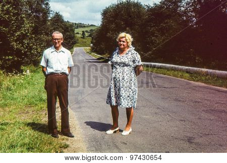 Vintage photo of couple on tar road (early 1970's)