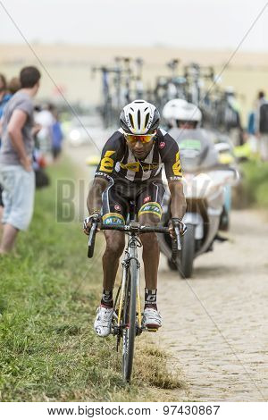Merhawi Kudus Ghebremedhin Riding On A Cobblestone Road - Tour De France 2015