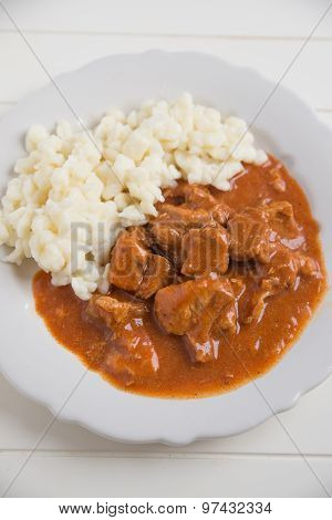 Traditional Hungarian goulash with small dumplings