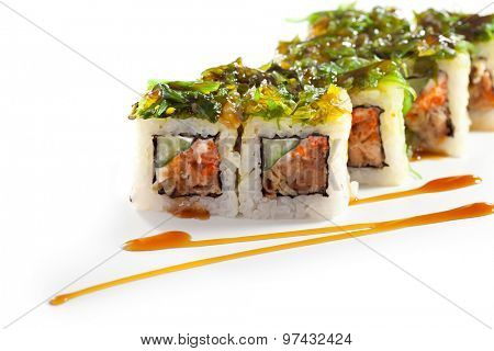 Maki Sushi - Roll with Fried Salmon, Cucumber and Cheese inside. Topped with Chuka Seaweed
