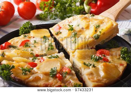 Sliced Spanish Omelette With Fried Potatoes. Horizontal Closeup