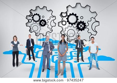 Business team against turning cogs