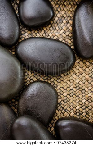 A piles of black stones at spa center