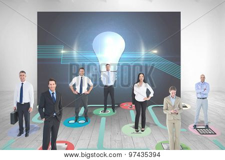 Business team against room with futuristic picture of light bulb
