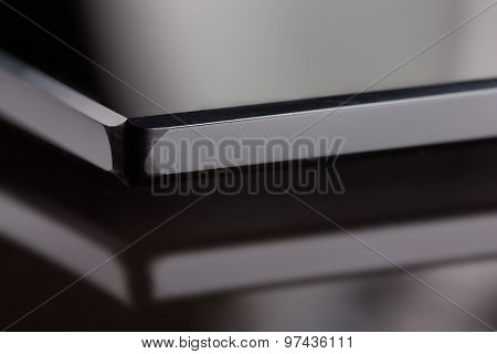 black sheet glass on the background with reflection.