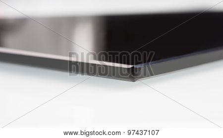 black sheet glass on a white. closeup