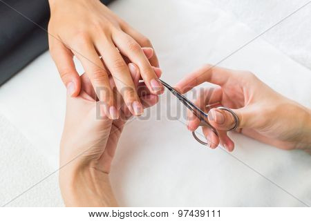 Lady having a manicure on her fingernails