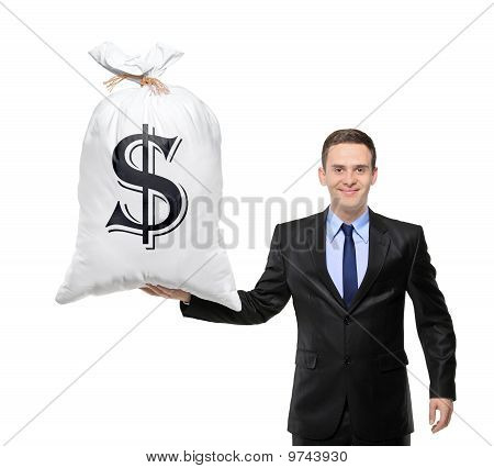 Happy Businessman Holding A Bag With Us Dollar Sign