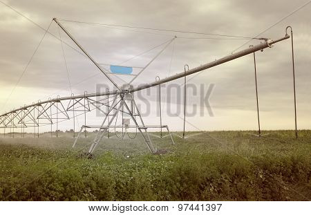Irrigation system on green field.