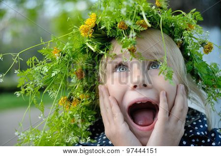Cute surprising child girl  open mouth and hand near the face