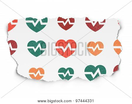 Healthcare concept: Heart icons on Torn Paper background
