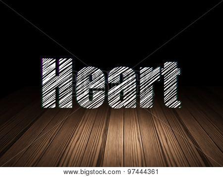 Healthcare concept: Heart in grunge dark room