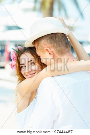 Attractive Young Couple Walking On A Luxury Waterfront In Summer Sunshine