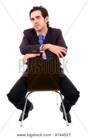 Businessman Sitting On Chair.