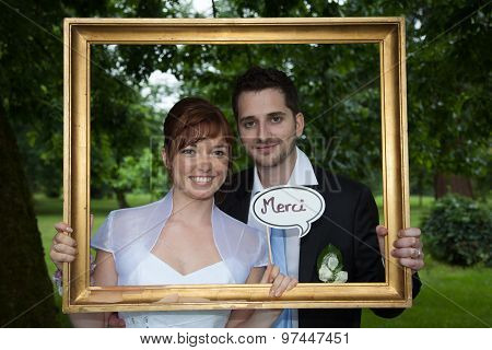 A Golden Board And Newly Young Wedding Couple