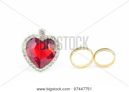Red Jewelry Heart And Two Golden Rings