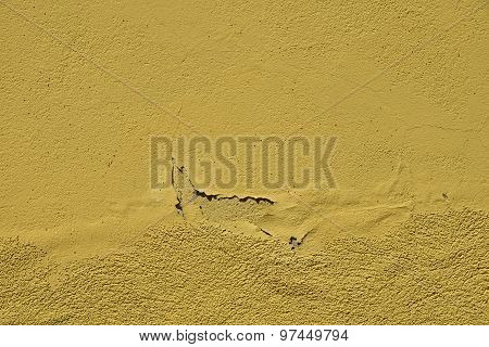 Vintage Flakes Of Old Yellow Paint Over Grey Concrete Wall