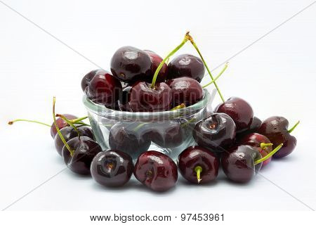 Cherry on a glass blow, white background