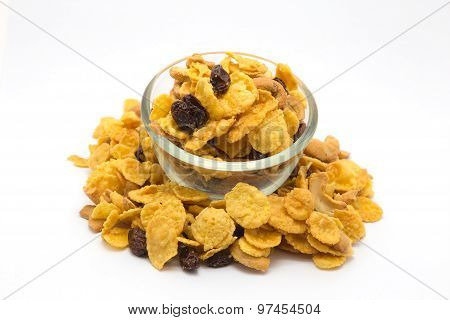 Homemade, a glass bowl of honey caramel cornflakes isolated on white