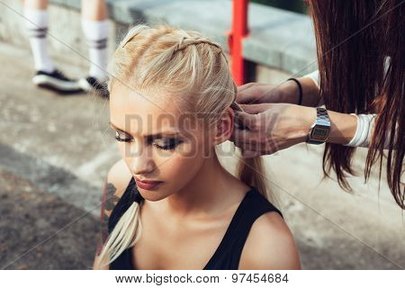 One Girl While Another Pulling Her Long Plait