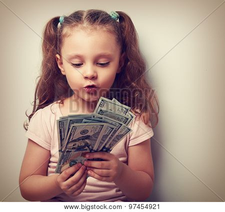Fun Grimacing Kid Girl Looking And Counting Money In The Hands. Vintage Portrait
