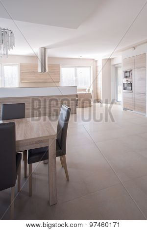 Wooden Table And Leather Chairs