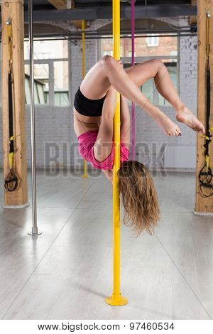 Woman Posing On A Pole