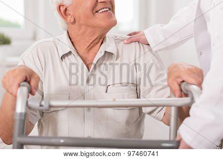 Senior Man With Walking Zimmer