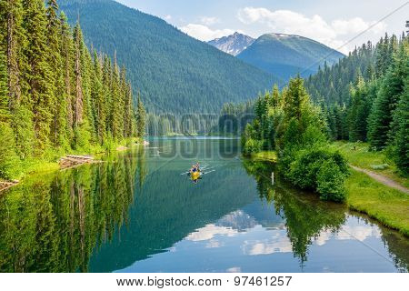 Majestic mountain lake in Canada. Lightning Lake in Manning Park in British Columbia. Boat.