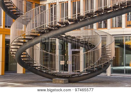 MUNICH, GERMANY - JULY 30, 2015: Rewriting stairs sculpture in form of a double helix, the sculpture is located in the courtyard of the KPMG office building