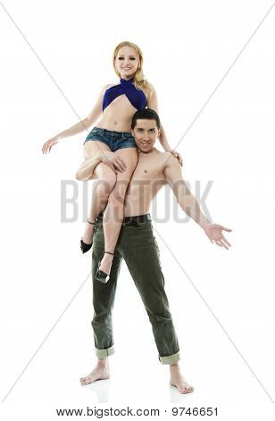 Man Carries On His Shoulders A Woman