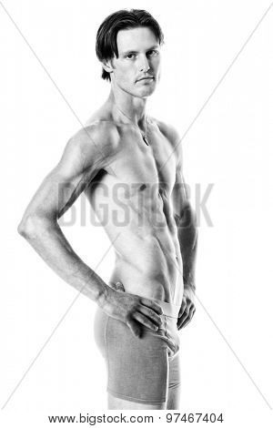Man in underwear. Studio shot over white. Black and white.