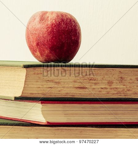 Old Books And Apple Education And Learning Symbol