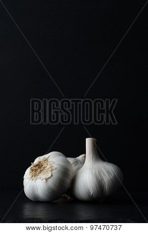 Garlic Bulbs On Black