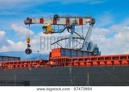 Harbor Crane Unloading Cargo