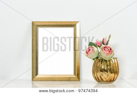Picture mock up with golden frame amd flowers. Vintage style interior
