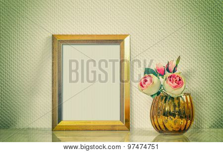 Picture mock up with golden frame amd flowers. Vintage style interior. Retro toned picture vibrant colors