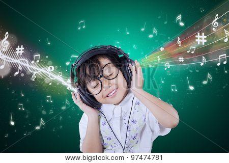 Adorable Small Girl Enjoy Music With Headphones