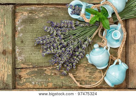 Lavender flowers over rustic wooden background. Fresh blossoms with country style decorations