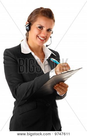 smiling modern business woman with headset and notebook