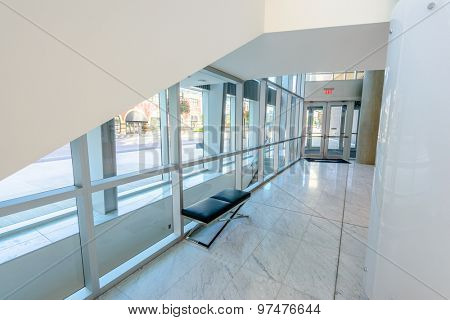 Bench and staircase. Abstract fragment of the architecture of modern lobby, hallway of the luxury hotel, shopping mall, business center in Vancouver, Canada. Interior design.