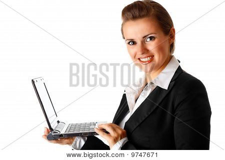 smiling modern business woman holding laptop in hand