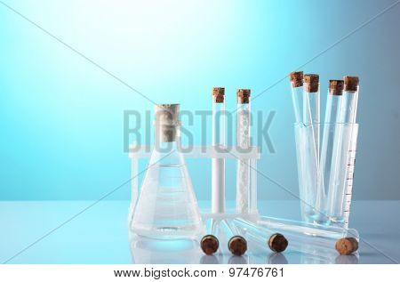 Empty laboratory test tubes  on blue background