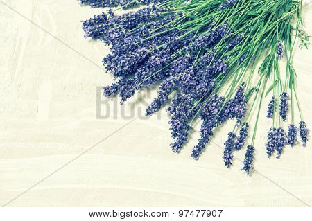 Lavender Flowers Over Rustic Wooden Background. Vintage Style