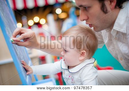 Image of cute little daughter with her young dad