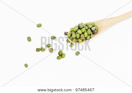 Mung Beans In Wooden Spoon Over White Background