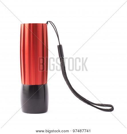 Red pocket flashlight isolated