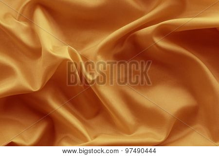 Closeup of lines in orange silk fabric
