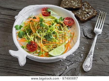 Fresh Salad With Zucchini And Carrots In A Light Vintage Plate On A Light Wooden Background