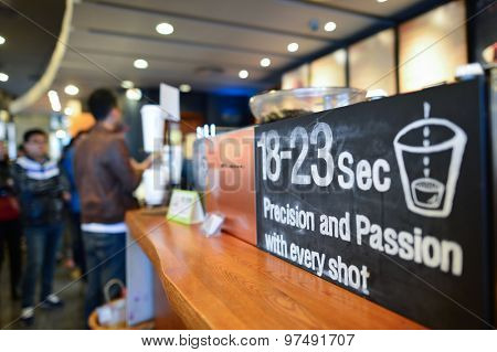 SHENZHEN, CHINA - JANYARY 11, 2015: Starbucks Cafe interior. Starbucks Corporation is an American global coffee company and coffeehouse chain based in Seattle, Washington
